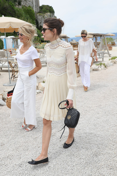 Charlotte Casiraghi was demure in a long-sleeve cream dress with lace panels and a pleated skirt at the Kering Women in Motion lunch.