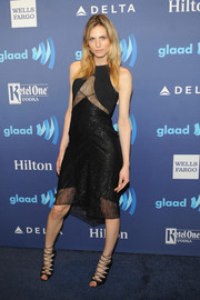 Andreja Pejic added an extra dose of sexiness with a pair of black gladiator heels.