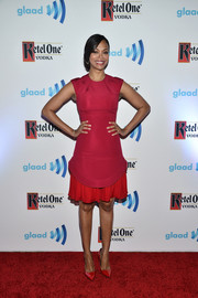 Zoe Saldana cut a girly figure at the GLAAD Media Awards in a red Cushnie et Ochs frock with a tight-fitting bodice and a pleated hem.
