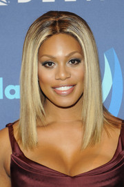 Laverne Cox attended the GLAAD Media Awards wearing her hair in a straight center-parted style.