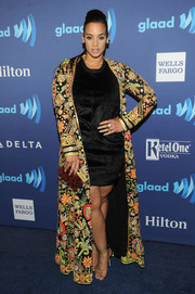 Dascha Polanco spiced up a simple LBD with an ornately embellished opera coat when she attended the GLAAD Media Awards.