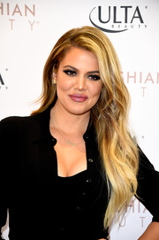 Khloe Kardashian wore her hair super long with beachy waves during her appearance at ULTA Beauty's West Hills store.