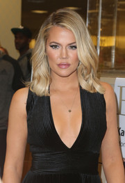 Khloe Kardashian swiped on plenty of lipgloss to highlight her pout.