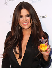 Khloe showed off her new fragrance 'Unbreakable' showing off bubble gum pink lipstick.