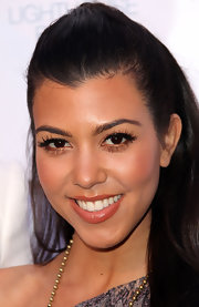 Kourtney Kardashian finished off her alluring look with glossy nude lipstick. Kourtney always knows the perfect way to highlight her radiant features.