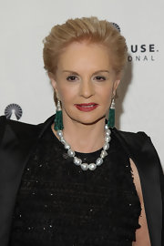 Designer Carolina Herrera showed off her style while attending the POSH Fashion Sale in a glamorous pearl necklace.