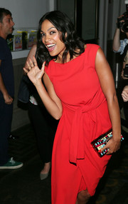 Rosario Dawson styled her dress with a printed box clutch by Paula Cademartori when she attended the 'Kids' 20th anniversary screening.