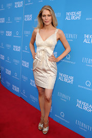Cynthia Kirchner paired her strappy sandals with a white bow embellished cocktail dress.