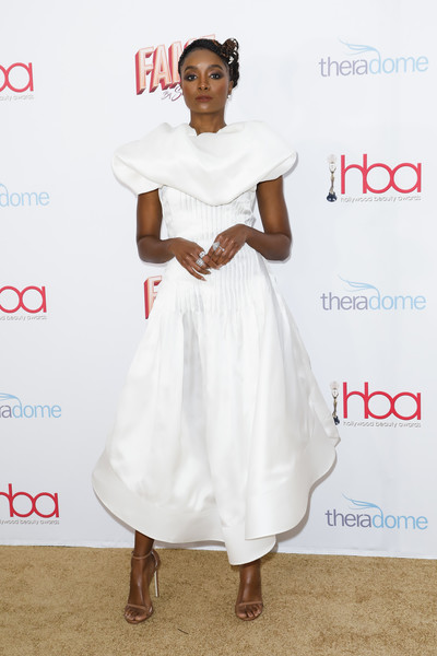 Kiki Layne Strappy Sandals [white,clothing,dress,shoulder,red carpet,fashion,hairstyle,cocktail dress,carpet,joint,kiki layne,the taglyan complex,los angeles,california,2020 hollywood beauty awards,rihanna,red carpet,celebrity,fashion,red carpet fashion,dress,model,actor,golden globe awards,party]