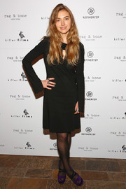 Imogen Poots matched her frock with sheer black tights.
