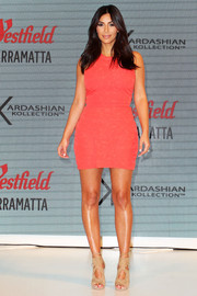 Kim Kardashian chose a simple, youthful coral Kardashian Kollection mini dress for the label's spring launch in Sydney.