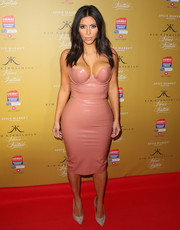 For her footwear, Kim Kardashian kept it simple with gray suede pumps by Giuseppe Zanotti.