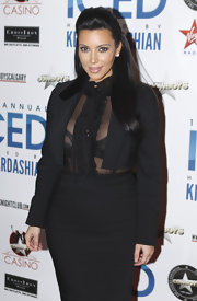 Kim Kardashian showed a little skin in her sheer black blouse at the Cowboys Dance Hall.