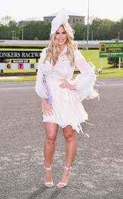 Kim Zolciak got dolled up in a feathered LWD for her Kentucky Derby hat contest.
