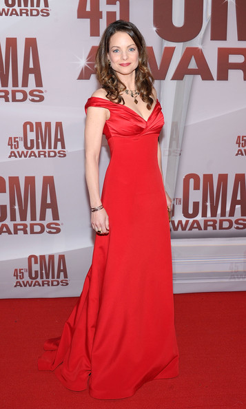 Kimberly Williams-Paisley Off-the-Shoulder Dress [dress,clothing,fashion model,shoulder,carpet,red carpet,red,gown,premiere,hairstyle,arrivals,kimberly williams-paisley,cma awards,nashville,tennessee,bridgestone arena]