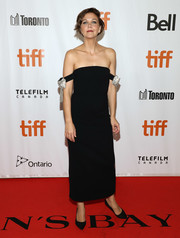 Maggie Gyllenhaal cut an elegant figure in a black off-the-shoulder dress with crystal bow detailing at the TIFF premiere of 'The Kindergarten Teacher.'