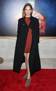 Ruth Wilson attended the Broadway opening of 'King Charles III' wearing a drapey black coat over a red suede dress.