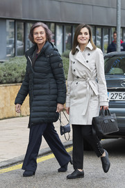 Queen Letizia of Spain donned a cream-colored trenchcoat and black trousers to visit King Juan Carlos at the hospital.