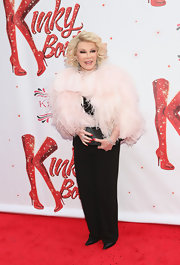Joan Rivers did not shy away from making a bold fashion statement when she chose this pink feathered jacket.