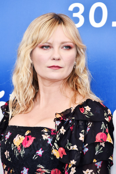 Kirsten Dunst Medium Wavy Cut with Bangs [hair,face,hairstyle,blond,lip,eyebrow,beauty,chin,long hair,brown hair,kirsten dunst,woodshock photocall - 74th,photocall,venice,italy,sala casino,venice film festival]