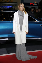Gwyneth Paltrow bundled up in elegant style with this white wool coat and gray evening dress combo, both by Michael Kors, for the Kitzbuehel Audi Night.