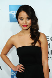 Jamie Chung paired her black dress and matching nails with a punch of rich red lipstick.
