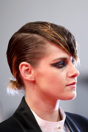 Kristen Stewart went majorly punky at the Cannes Film Festival screening of 'Knife + Heart' wearing this knot with emo bangs.