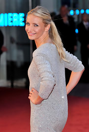 The actress wore a sequined sweater dress with a simple low ponytail.