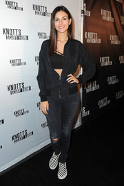 Victoria Justice attended the Knott's Scary Farm Black Carpet event wearing a simple zip-up jacket over a crop-top.
