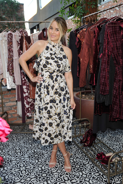 Lauren Conrad was all about summertime charm in this floral halter dress from her own line during the Girls' Night Out party.