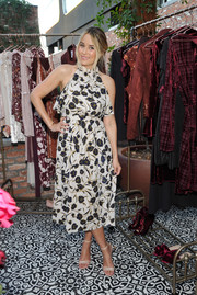 Lauren Conrad styled her dress with a pair of skinny-strap sandals, also from her line.