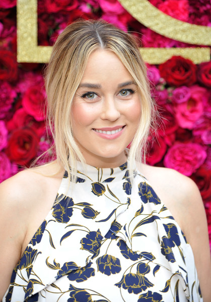 Lauren Conrad styled her hair into a loose center-parted updo for the Girls' Night Out party.