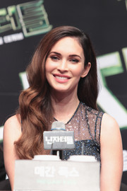 Megan Fox wore a gorgeous wavy hairstyle to the 'Teenage Mutant Ninja Turtles' press conference in Seoul.