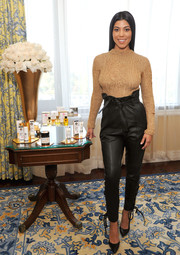 Kourtney Kardashian looked effortlessly stylish in a nude open-weave sweater by Natalia Fedner while appearing on Amazon's 'Style Code Live.'