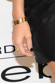 Kourtney Kardashian added a little gleam to her look with classic gold bangle bracelets.