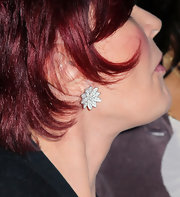 Sharon Osbourne flashed a couple of diamond jewelry pieces at an anniversary gala including a pair of flower earring studs.