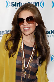 Thalia accessorized her outfit with layers of beaded necklaces at the SiriusXM Studio.