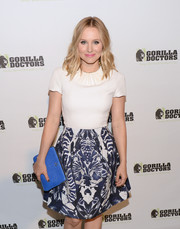 Kristen Bell's blue leather clutch provided a bright finish to her look during the Gorilla Doctors of Africa benefit.