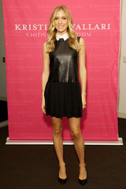 Kristin Cavallari went for an edgy schoolgirl look with this black mini dress featuring a leather bodice and a white collar when she hosted the Akira fall fashion show.