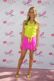 Kristin Cavallari broke out the brights for her visit to ULTA's Kiss Kart, pairing a pink mini skirt with a yellow top.