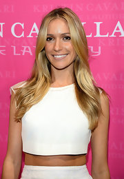 Kristin's opted for a straight 'do with a center part for her look while promoting her new shoe line.