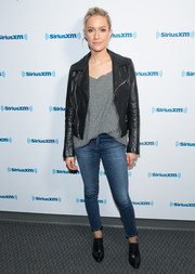 Kristin Cavallari teamed a black leather jacket with a loose gray shirt for her appearance on SiriusXM's 'Conversations with Maria.'