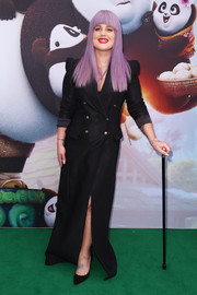 Kelly Osbourne attended the Australian premiere of 'Kung Fu Panda 3' wearing a floor-grazing black double-breasted coat.