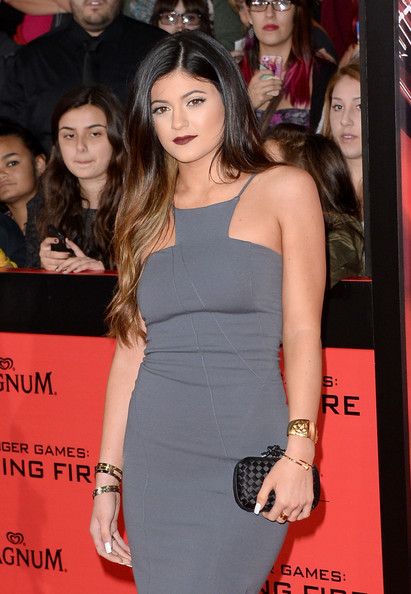 Kylie Jenner Satin Clutch [the hunger games: catching fire,clothing,premiere,shoulder,dress,event,red carpet,long hair,carpet,joint,cocktail dress,arrivals,kylie jenner,nokia theatre l.a. live,california,los angeles,lionsgate,premiere]