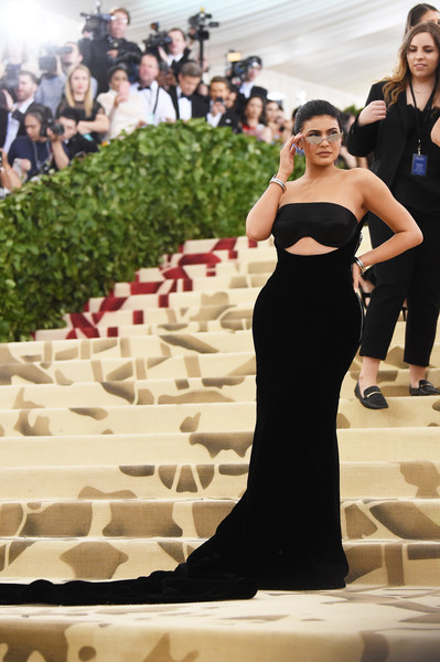 Kylie Jenner Cutout Dress [gown,dress,beauty,flooring,shoulder,girl,fashion,carpet,fashion model,formal wear,kylie jenner,new york city,metropolitan museum of art,heavenly bodies: fashion the catholic imagination costume institute gala - arrivals,kylie jenner,2018 met gala,metropolitan museum of art,kendall jenner,red carpet,fashion,celebrity,museum,art museum,2018]