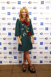 Kylie Minogue wore a hunter green Dolce and Gabbana dress with sequined red roses to the World Famous Oxford Street Christmas Lights Switch On at the Pandora Flagship Store in London, England.