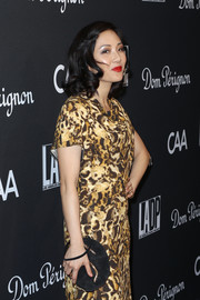 Constance Wu arrived for the L.A. Dance Project Gala carrying a black suede clutch with gold accents.