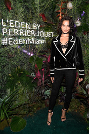 Shanina Shaik made an appearance at the L'Eden by Perrier-Jouet opening wearing a black One Teaspoon velvet blazer with white piping.