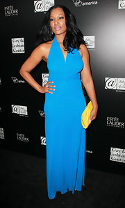 Garcelle Beauvais wore a bright blue halter gown with a gathered bodice for the homeless youth services benefit.