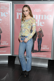Lily-Rose Depp went casual in a floral sweater at the Paris premiere of 'L'Homme Fidele.'